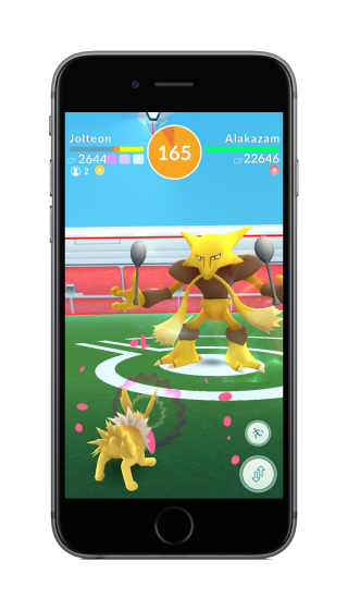 pokemon_go_screenshot_of_new_raid_feature_gym_battle_between_jolteon_and_alakazam