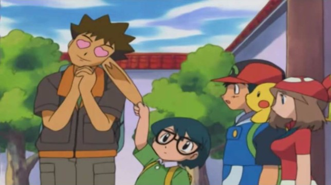 brock_with_hearts_as_eyes_as_max_pulls_his_ear_as_may_ash_and_pikachu_watch_in_pokemon