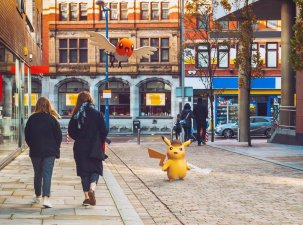 live_action_photo_of_detective_pikachu_and_fletchling_in_ryme_city