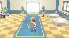 first_pokemon_lets_go_pikachu_and_lets_go_eevee_screenshot_of_new_mythical_hex_nut_pokemon_meltan_interacting_with_male_trainer