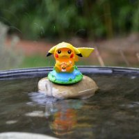 New Funko figure A Day with Pikachu: Rainy Day Pokémon features sad Pikachu clinging to Castform while it's raining outside