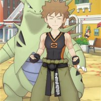 Official screenshot of Brock in his sygna suit with Tyranitar as his partner Pokémon in Pokémon Masters